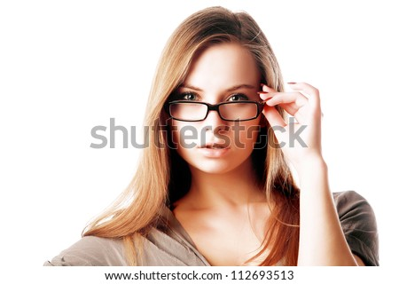 Sexy blonde woman wearing glasses isolated against white background - stock photo