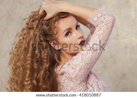 Sexy blonde woman with fashion make-up and curly hair. Skin care concept - stock photo