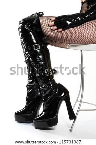 Sexy Boots and Legs on Leather Chair - stock photo