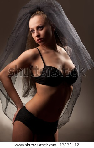 Sexy bride in veil and black lingerie - stock photo