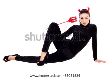 sexy brunette girl wearing a halloween costume of an imp - stock photo