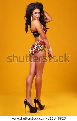 sexy brunette in retro swimsuit  - stock photo