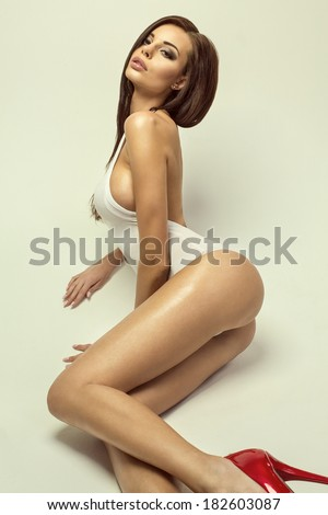 Sexy brunette in sensual poses - stock photo