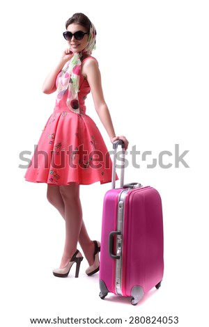 Sexy brunette in the style of pin-up posing with a pink bag on an isolated white background. - stock photo
