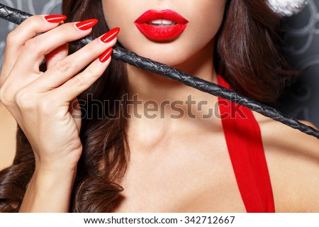 Sexy brunette santa woman with whip closeup, bdsm - stock photo