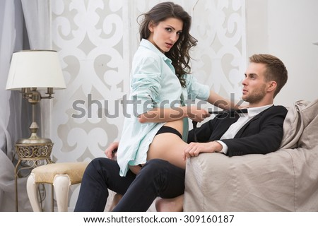 Sexy brunette seduced a guy in business suit - stock photo