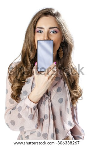 Sexy brunette showing smart phone isolated on white background - stock photo