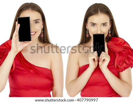 Sexy brunette showing smart phone. Young woman in red dress isolated on white background - stock photo