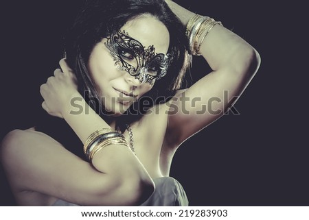 Sexy Brunette with venetian mask. sensuality concept - stock photo