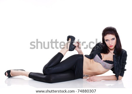 Sexy brunette woman in leather jacket on white background - stock photo