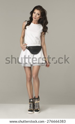 Sexy brunette woman in sports set. - stock photo