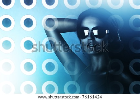 sexy brunette woman in sunglasses and hologram - stock photo