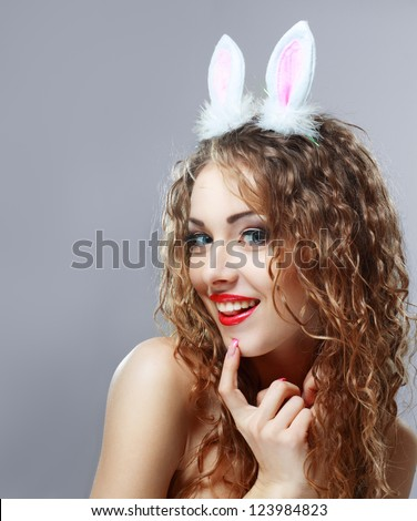 Sexy bunny girl. Isolated over pink background - stock photo