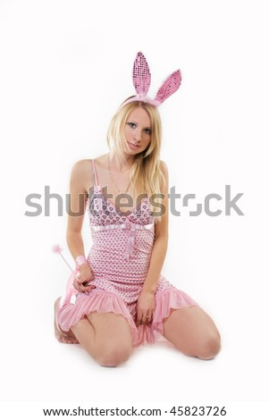 Sexy bunny girl. Isolated over white - stock photo