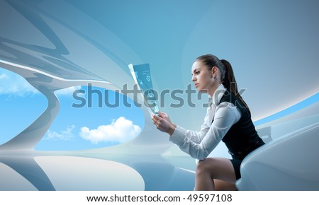Sexy businesswoman examining future digital report / newspaper (outstanding business people in interiors / interfaces series) - stock photo