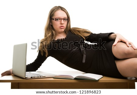 Sexy businesswoman lying on the desk isolated on white - stock photo