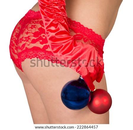 sexy butt of a woman and christmas tree balls / Christmas - stock photo