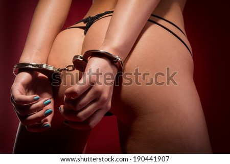 sexy buttocks and hands in manacle - stock photo