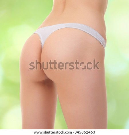 Sexy buttocks in lingerie , on a green background - stock photo