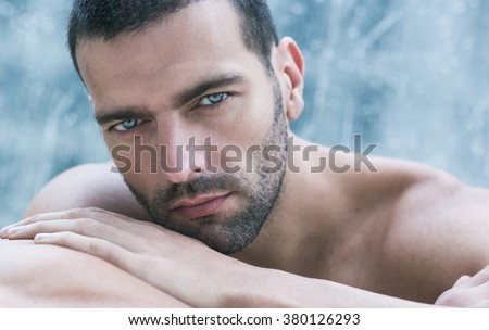 Sexy closeup portrait of handsome topless male model. Beautiful eyes. - stock photo
