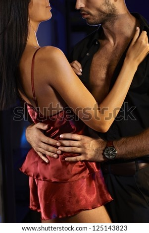 Sexy couple embracing, making love. - stock photo