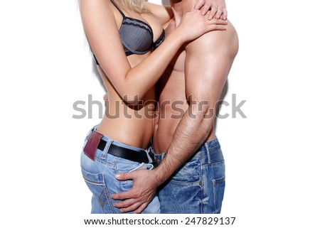 Sexy couple foreplay in jeans at wall concept - stock photo