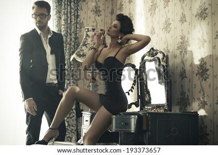 Sexy couple in bedroom  - stock photo