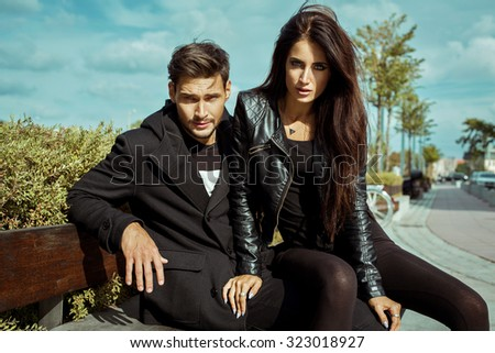 Sexy couple in jacket in autumn scenery - stock photo