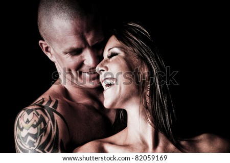 Sexy Couple in love laughing together - stock photo