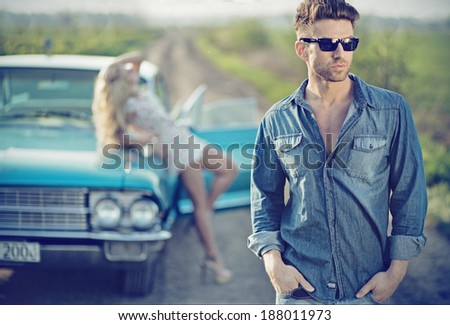 Sexy couple in the car - stock photo