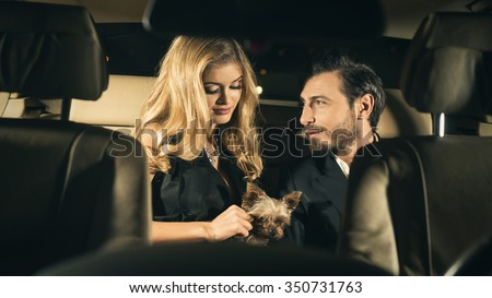 Sexy couple in the car. Focus on man  - stock photo