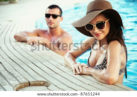 Sexy couple on sunny vacation day - stock photo
