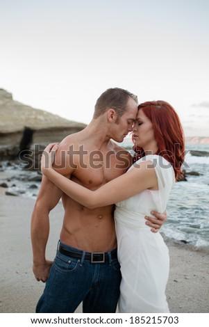 Sexy Couple on the Beach - stock photo