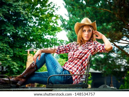 Sexy cowgirl. Young woman portrait in a hat - stock photo