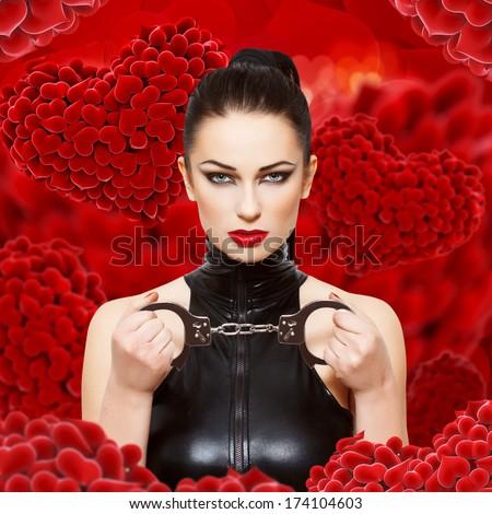 Sexy dominatrix with handcuffs - stock photo
