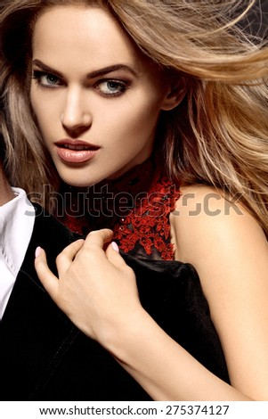 Sexy elegant couple in the tender passion. Beautiful woman near the man. - stock photo