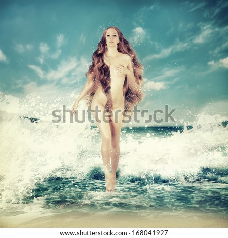 Sexy fairy slim woman with long curly hair - Aphrodite is in sea water in a spray of sea waves - stock photo