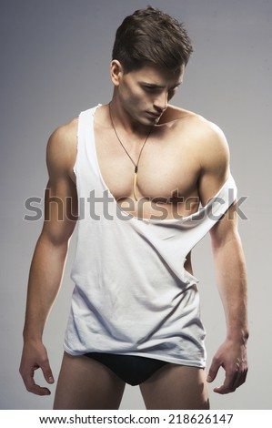 Sexy fashion portrait of a hot male model  - stock photo