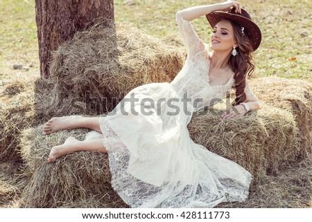 Sexy fashion woman wear wedding dress and smiling  - stock photo