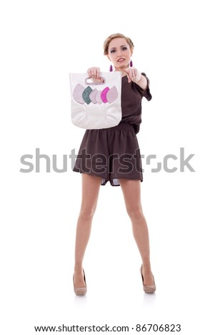 sexy fashion woman with hand bag pointing to the camera - stock photo