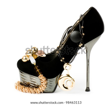 Sexy fashionable shoe with golden jewelry on background - stock photo