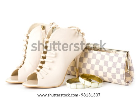 Sexy fashionable shoes, golden jewelry  and handbag isolated on white background. - stock photo