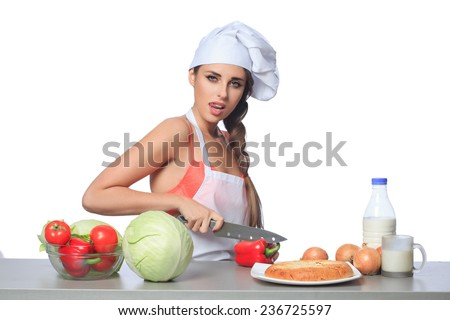 sexy female chef holding a knife with expression - stock photo