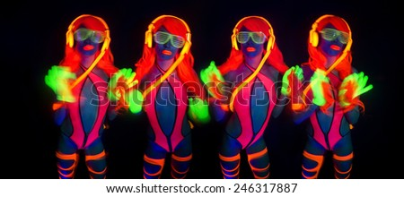 sexy female disco dancer poses in UV costume - stock photo