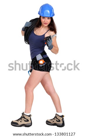 Sexy female electrician - stock photo