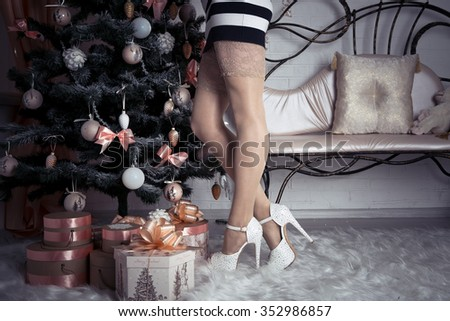 sexy female legs in beautiful shoes for Christmas - stock photo