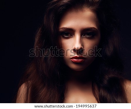 Sexy female model face with long hair. Dramatic light. Closeup - stock photo
