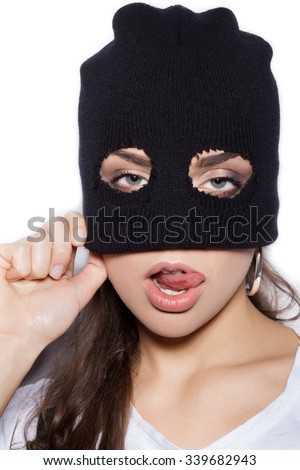 sexy female model in balaclava - crime and violence on white background not isolated - stock photo