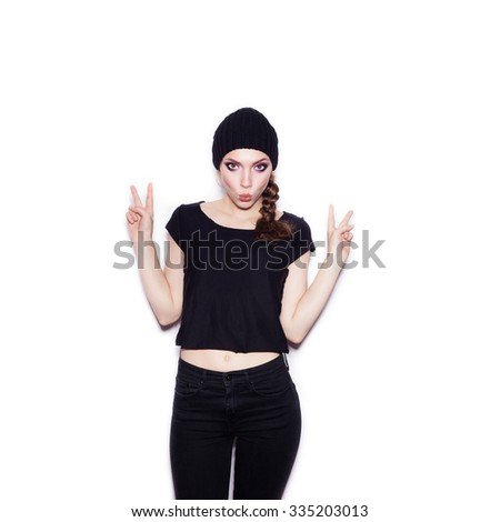 Sexy female model in black clothes having fun. Portrait of expressive girl on white background not isolated  - stock photo