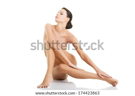 Sexy fit naked woman with healthy clean skin, isolated on white background  - stock photo